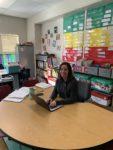 teacher at her desk